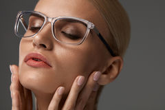 Women Fashion Glasses. Girl In Stylish Grey Eyeglasses, Eyewear. Women Fashion Glasses. Beautiful Sexy Young Female Wearing Stylish Optical Eyeglasses On Grey Royalty Free Stock Image