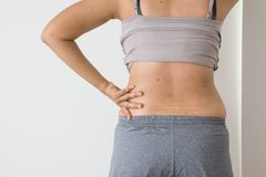 Women fat belly fat with stretch marks. On white background royalty free stock photography
