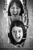 Women in fear. Women locked door and aggressive Royalty Free Stock Photos
