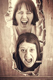 Women in fear. Women locked door and aggressive Royalty Free Stock Images