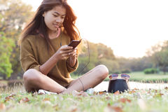 Women feel relax use smart phone mobile at evening Stock Photography