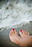Women feet. Woman feet - lonely day at the beach Stock Image