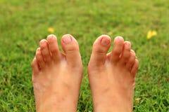 Women feet in the grass. The women feet relex  in the grass Stock Photos