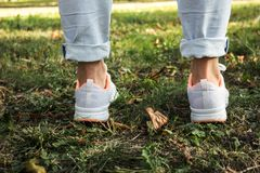 Women feet in light sneakers urban style Royalty Free Stock Photography