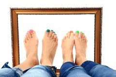 Women feet and old frame Stock Photos