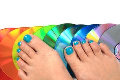 Women feet (pedicure)  with cd and dvd Stock Image
