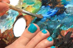 Women feet (pedicure)  with color palette Royalty Free Stock Photo