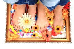 Women feet (pedicure)  with flowers Royalty Free Stock Images