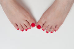 Women feet after pedicure with red nails Stock Photos