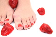 Women feet (pedicure) with  strawberries Stock Images