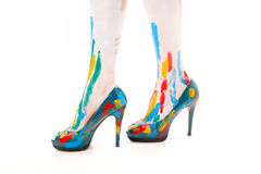 Women feet with shoes and paint Royalty Free Stock Photography