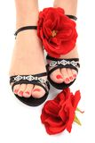 Women feets and flowers (pedicure tbackground) Royalty Free Stock Photo