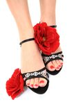 Women feets and flowers (pedicure tbackground) Stock Photo