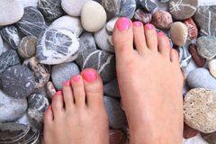 Women feets and stones Royalty Free Stock Images