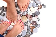 Women feets and stones Royalty Free Stock Image