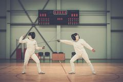 Women on a fencing training Stock Photos