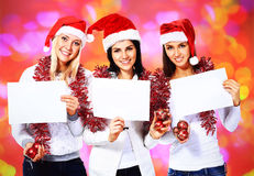 women on festive Christmas background Stock Images