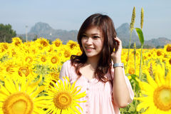 Women in field of sunflowers Royalty Free Stock Image