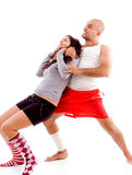Women fighting with muscular male Royalty Free Stock Photography