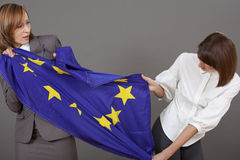 Women fighting over european flag Stock Images