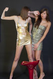 Women fighting on the party. Two young women in mini dresses fighting on the party Stock Photo