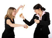 Women fighting with rubber stamps Stock Image