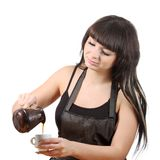 Women fill coffee cup Stock Photo