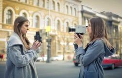 Women filming Stock Image
