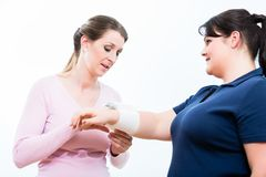 Women in First aid course learning to apply bandages Stock Photo