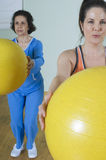 Women With Fitness Ball Royalty Free Stock Images