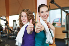 Women in fitness center holding Royalty Free Stock Image