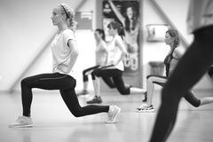 Women fitness group training leg muscles Royalty Free Stock Images