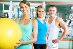 Women with fitness trainer stock photos