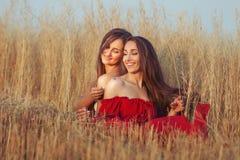 Women flirt in the field. Stock Photo