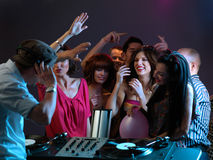 Women flirting with dj in night club Stock Photo