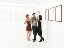 Women flirting with man in art gallery Royalty Free Stock Photography