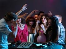 Women Flirting With Dj In Night Club Stock Photo