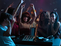 Women Flirting With Dj In Night Club Royalty Free Stock Photo