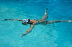 Women floating in swimming pool royalty free stock photos