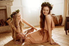 Women in floral wreaths Stock Photography