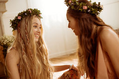 Women in floral wreaths Stock Photos