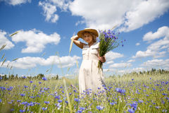 Women in flower field Royalty Free Stock Photo