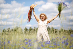 Women in flower field Stock Image
