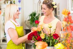 Women in the flower store buying roses Stock Images