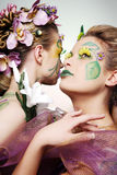 Women in flowers. Royalty Free Stock Image