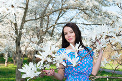 Women and flowers of Magnolia Stock Photos