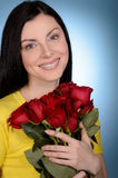 Women with flowers. Portrait of beautiful middle-aged women hold royalty free stock image