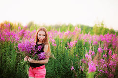 Women in flowers. Royalty Free Stock Photography