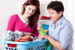 Women folding laundry Stock Image