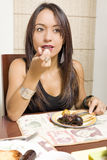 Women and food. Woman eating nice food at home Royalty Free Stock Images